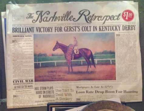 a copy of The Nashville Retrospect on display at The Gerst Haus featuring the original 1910 story of Donau winning the Kentucky Derby - the original painting of Donau is also on display at the restaurant