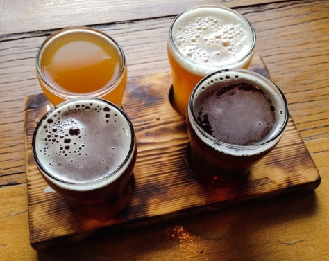 a sampler tray at Jackalope (clockwise from top left): Caspar the Gose; Hoppy Anniversary IPA; Rompo Red Rye Ale; Leghorn Rye IPA